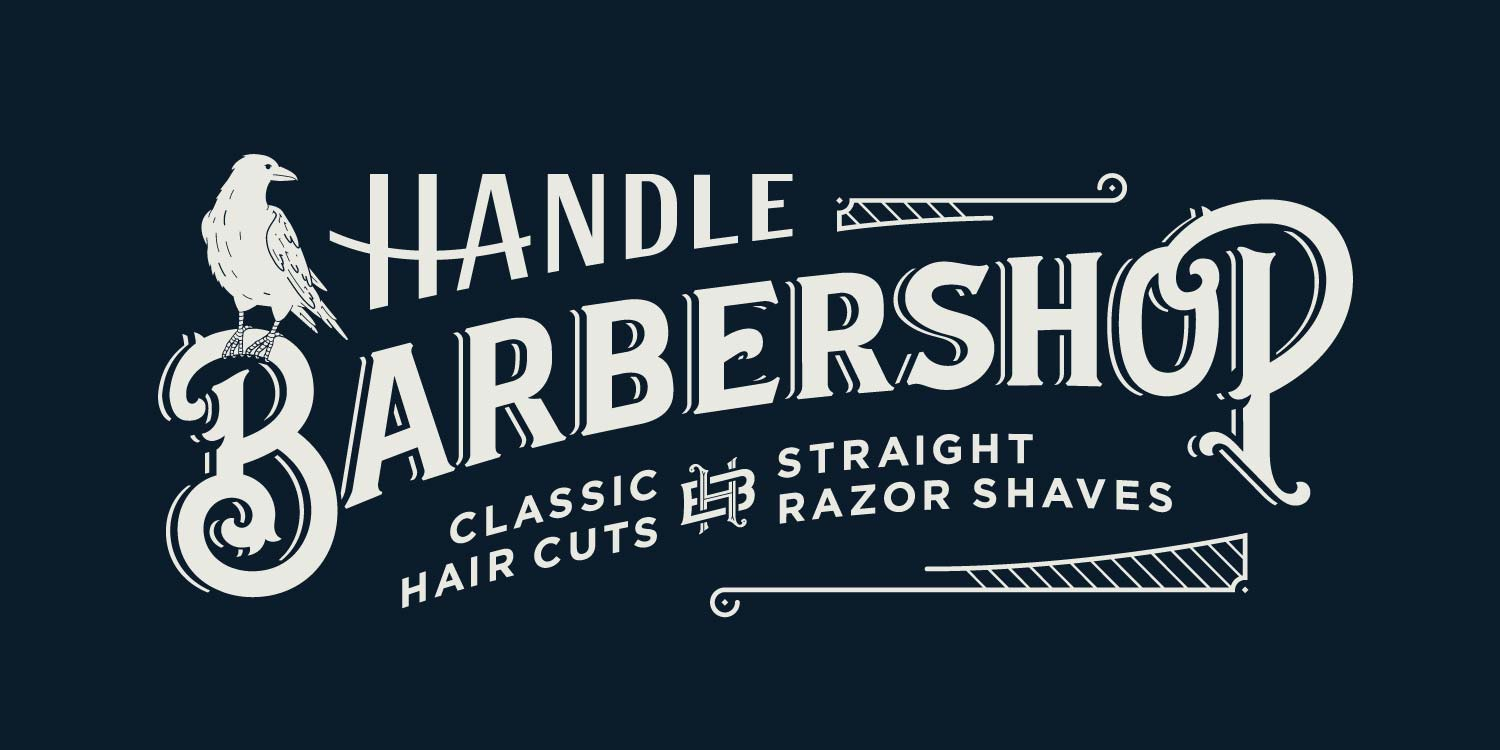 Handle Barbershop vinyl window signage in downtown Little Rock, Arkansas in Victorian style with perched raven—by Hunter Oden of oden.house