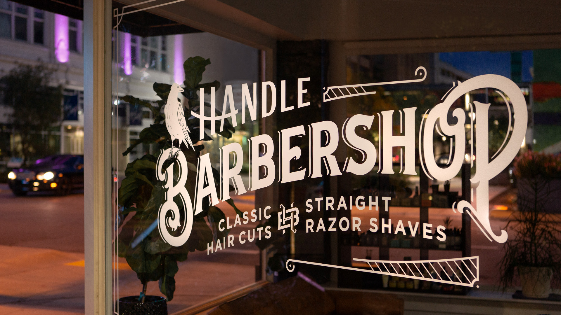 Overview photograph of barbers working at Handle Barbershop in Little Rock, Arkansas